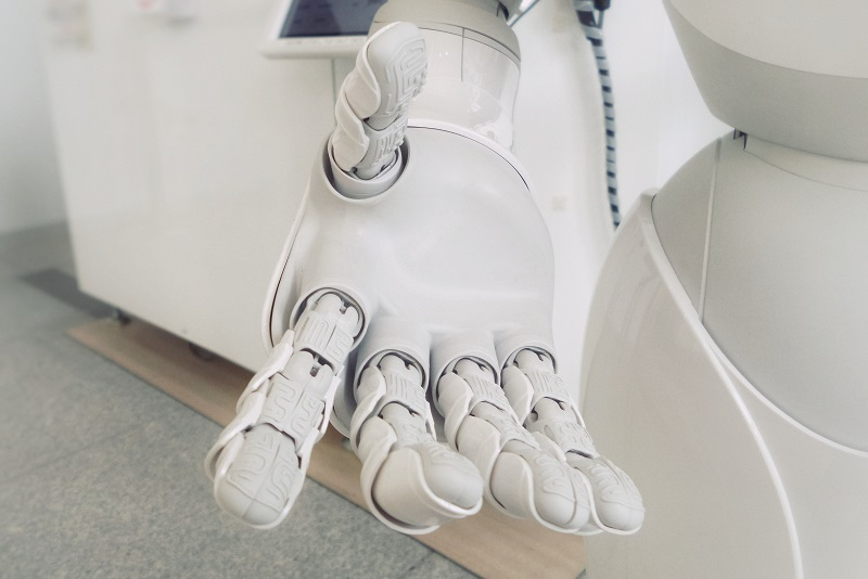 white robot hands reaching out